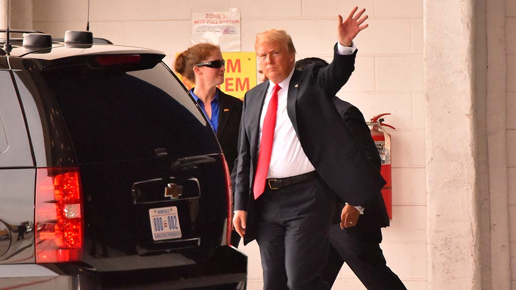President Trump waves farewell to MCAS Miramar after a half-hour visit.