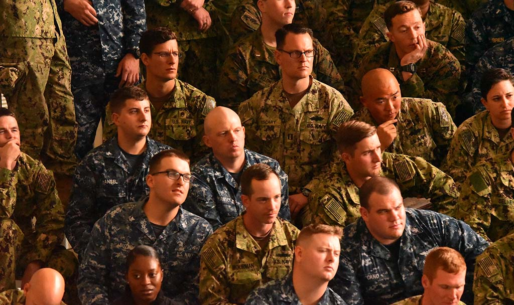 A mixture of expressions as Marines listen to President Trump on his first visit to MCAS Miramar.