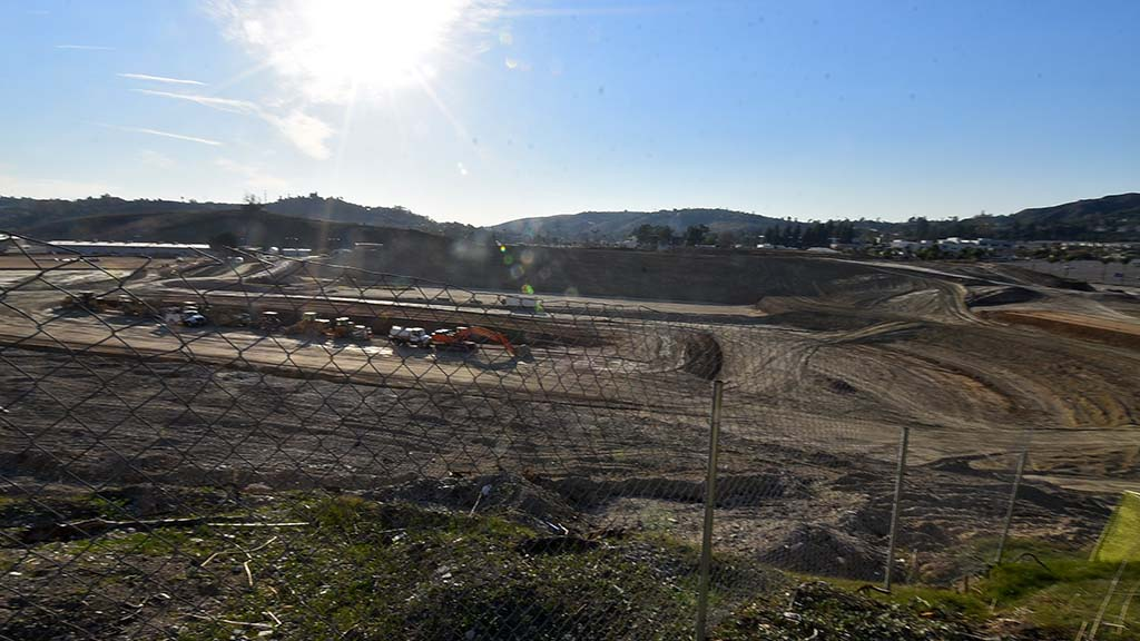 View from east shows setting sun over grading project at Hilmer Lodge Stadium site at Mt. SAC
