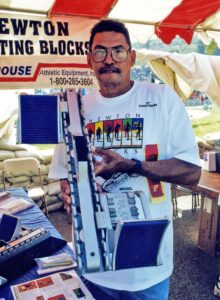 Nick Newton displays set of starting blocks at the Mt. SAC Relays in the late 1990s.