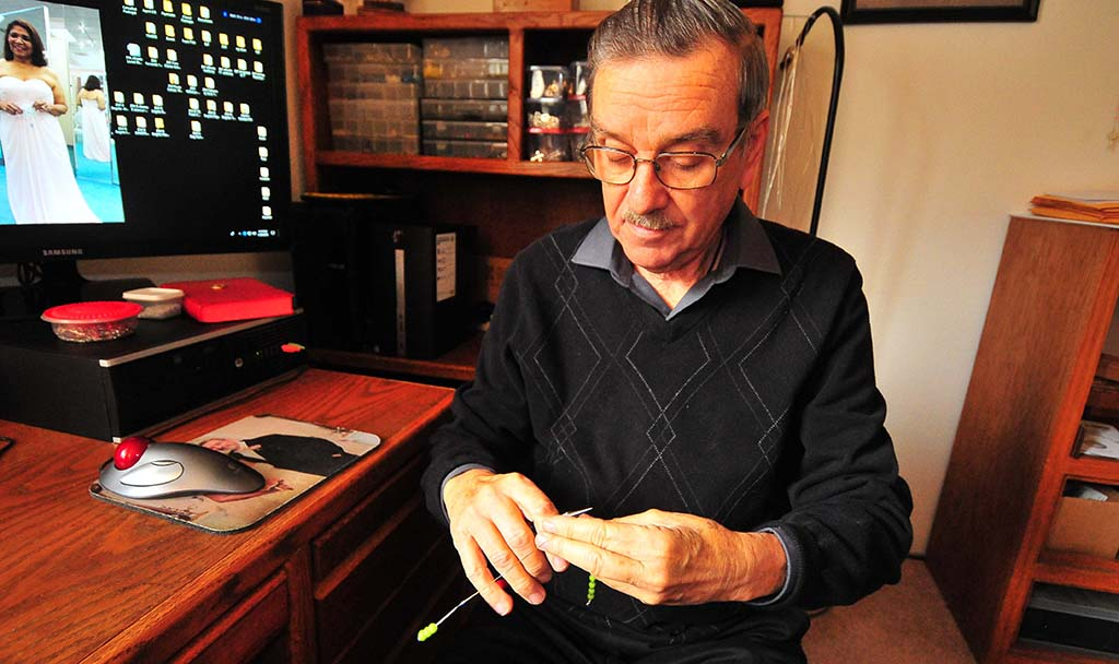 Tony Blanco, 72, makes one of the many thousand rosaries he has pieced together over the years.
