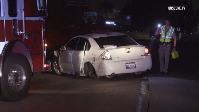 CHP officer inspects damaged car