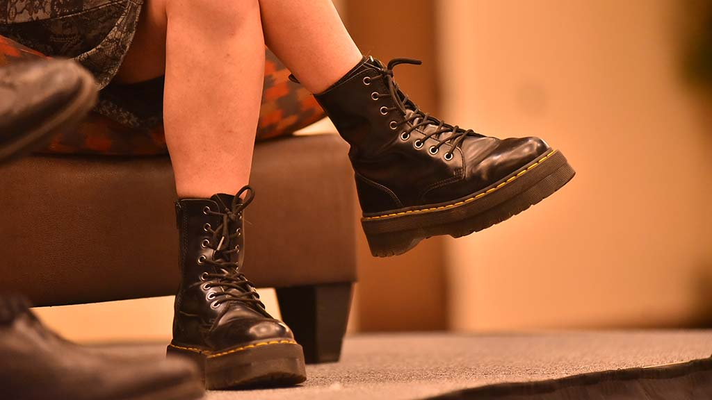 Chelsea Manning wore a dress and military-style boots.