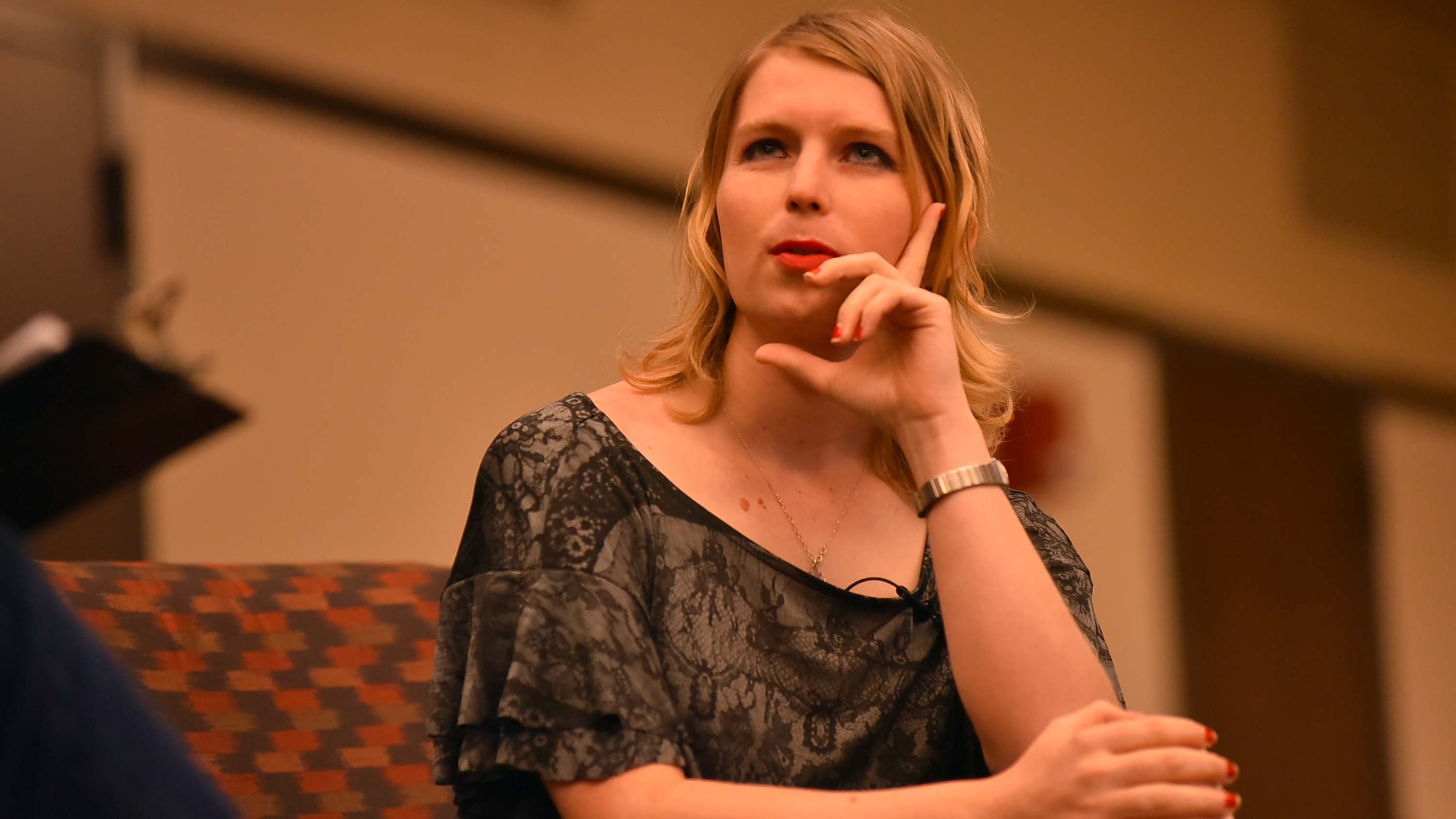 Chelsea Manning pauses and thinks about a question that was asked.