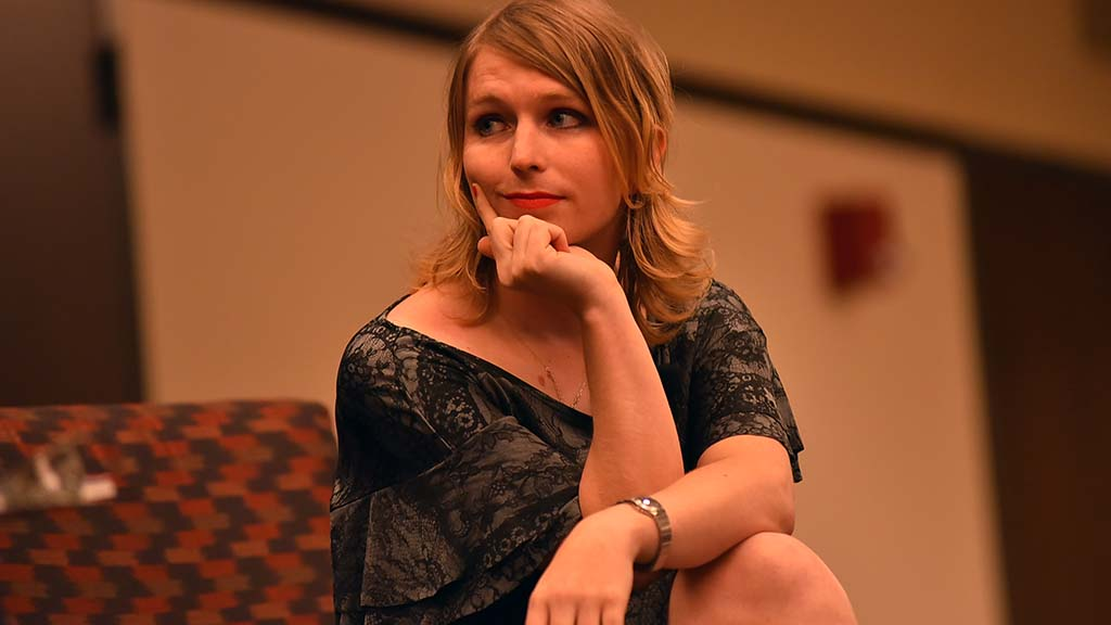 Chelsea Manning listens to a question asked by Mark Wheeler, associate professor of philosophy.