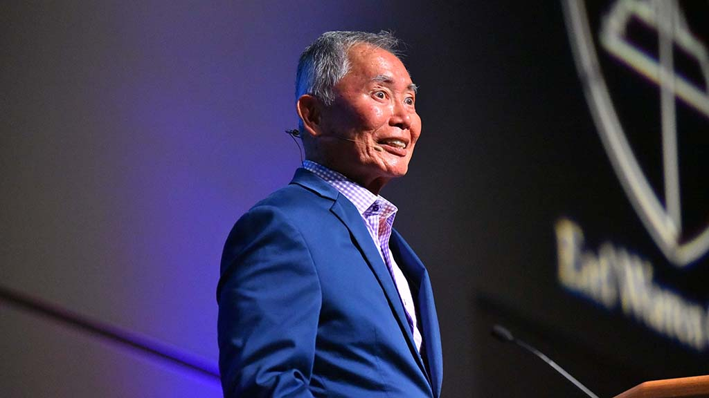 Actor-activist George Takei talked about realizing he was gay and spotting a good looking male.