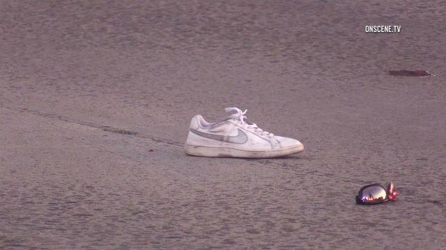Pedestrian's shoe and sunglasses