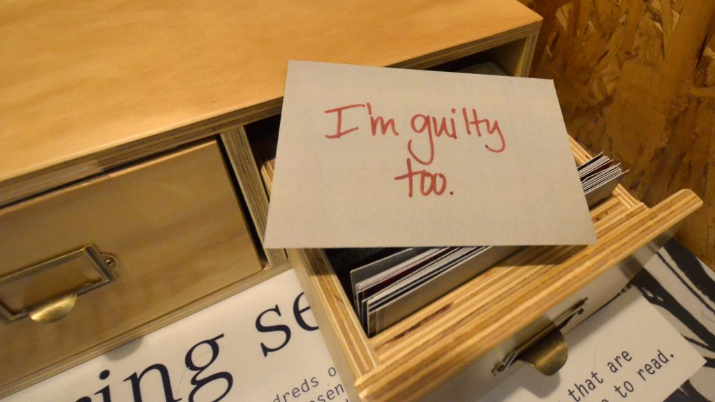 Visitors have a chance to sift through filing drawers of secrets and choose their favorites.