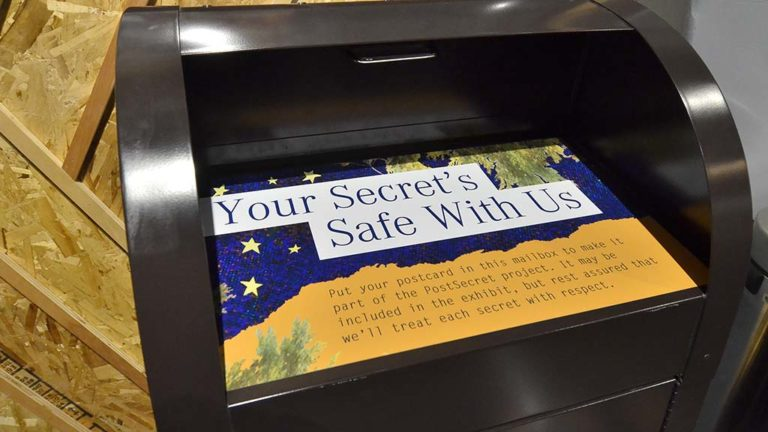 San Diego Museum of Man visitors are invited to write their own postcards and deposit them into the mailbox.