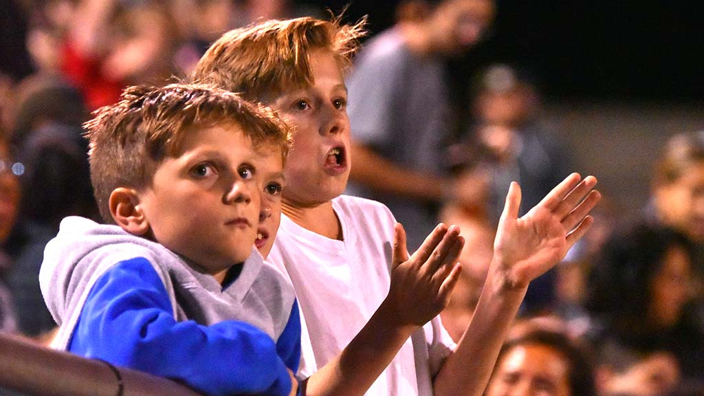 Young fans cheer on the Legion during a preseason game.