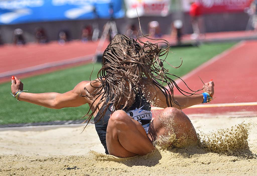 Tara Davis of Georgia is enveloped in hair in winning the invitational long jump at the Mt. SAC Relays.