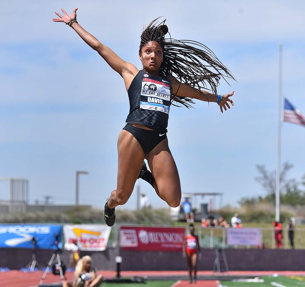Tara Davis of Georgia gets height in the invitational long jump at the Mt. SAC Relays.