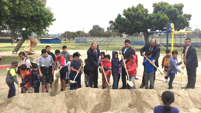 With children helping, Mayor Kevin Faulconer, Councilman David Alvarez and other community leaders break ground on Memorial Community Park expansion in Logan Heights.