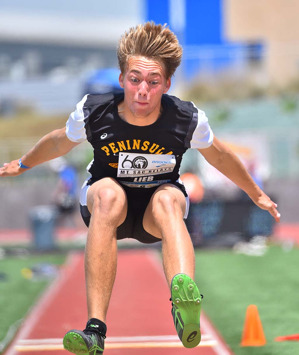 Aiden Lieb of Peninsula High School has a hair-raising land in the boys triple jump at the Mt. SAC Relays.