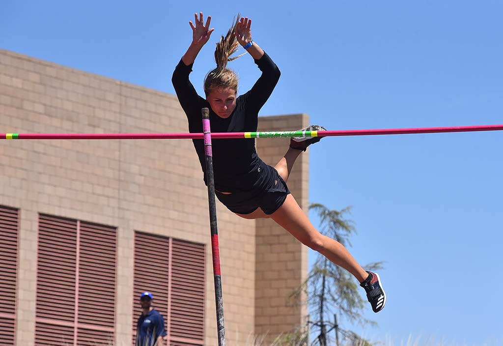 An entrant in the women's elite pole vault flies away from the bar at the Mt. SAC Relays.