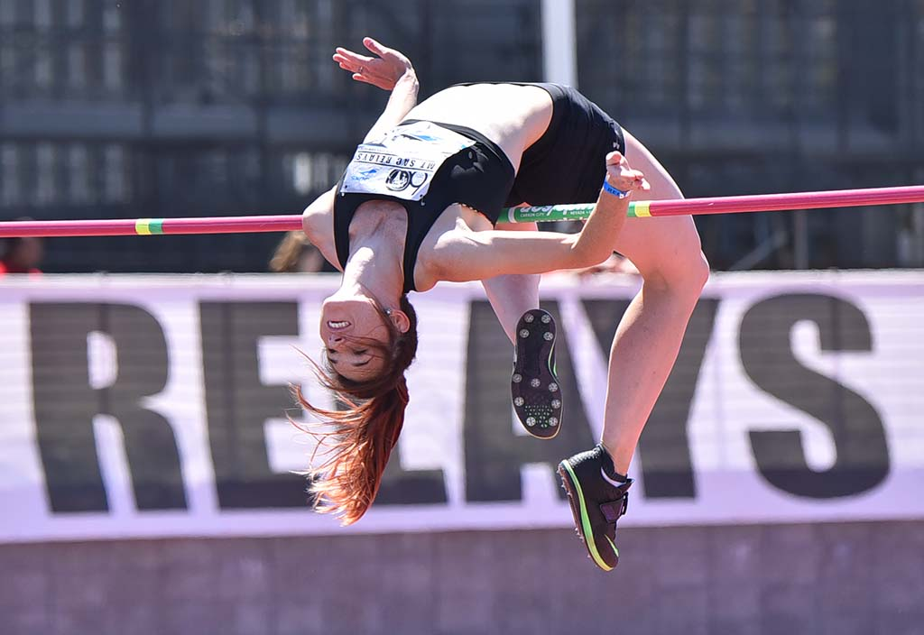 Tatiana Gusin of Georgia arches over bar in women's invitational high jump at Mt. SAC Relays.