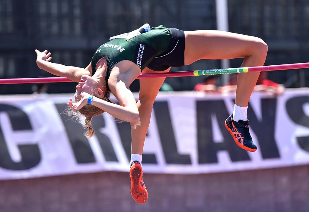 Lily Lowe of Hawaii clears bar on way to her fifth-place 6-0 mark at Mt. SAC Relays.
