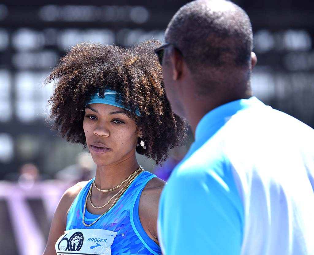 Vashti Cunningham consults with her coach, and father, Randall Cunningham at Mt. SAC Relays.