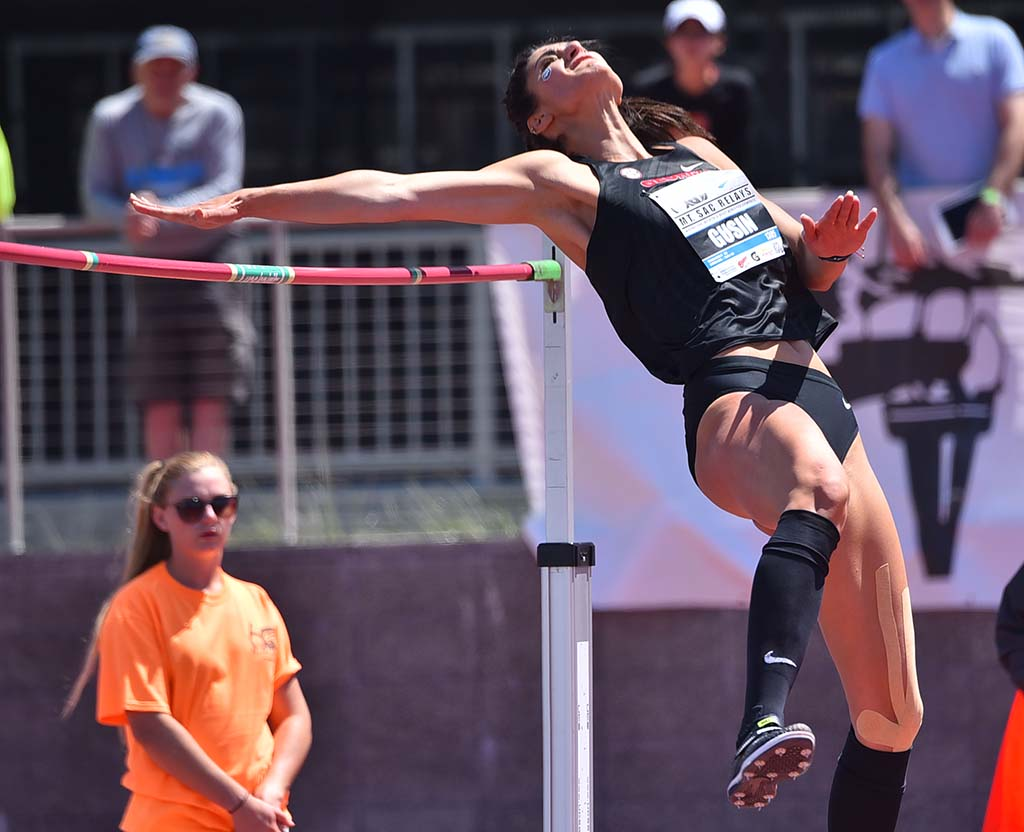 Tatiana Gusin of Georgia stretched toward the bar on the way to finishing third at 6-2 at Mt. SAC Relays.