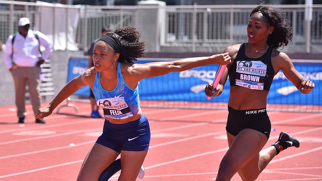 Aaliyah Brown hands off to Allyson Felix at Mt. SAC Relays invitational 4x100 relay.