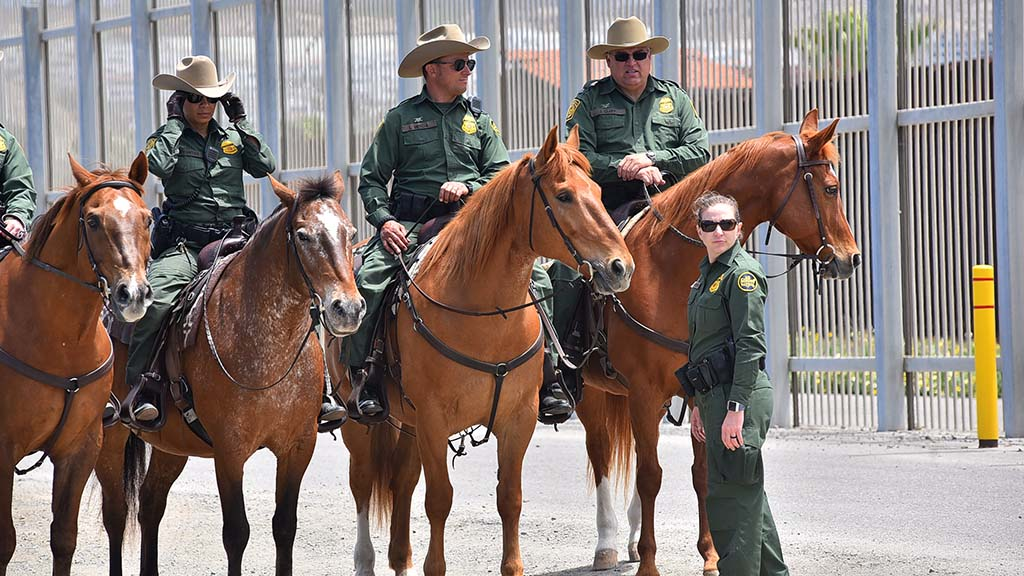 Border Patrol on horseback foot and on foot were at the border during the press conference.