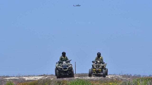 Helicopters flew over the river valley north of the border while agents patrolled on ATVs.