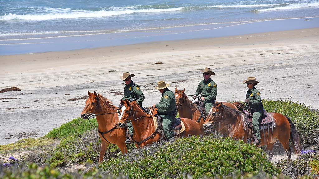 Border Patrol agents surveyed the beach and area around Border Field State Park.
