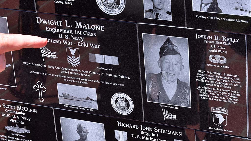 Joe Reilly of Santee points to his plaque at Mt. Soledad National Veterans Memorial.
