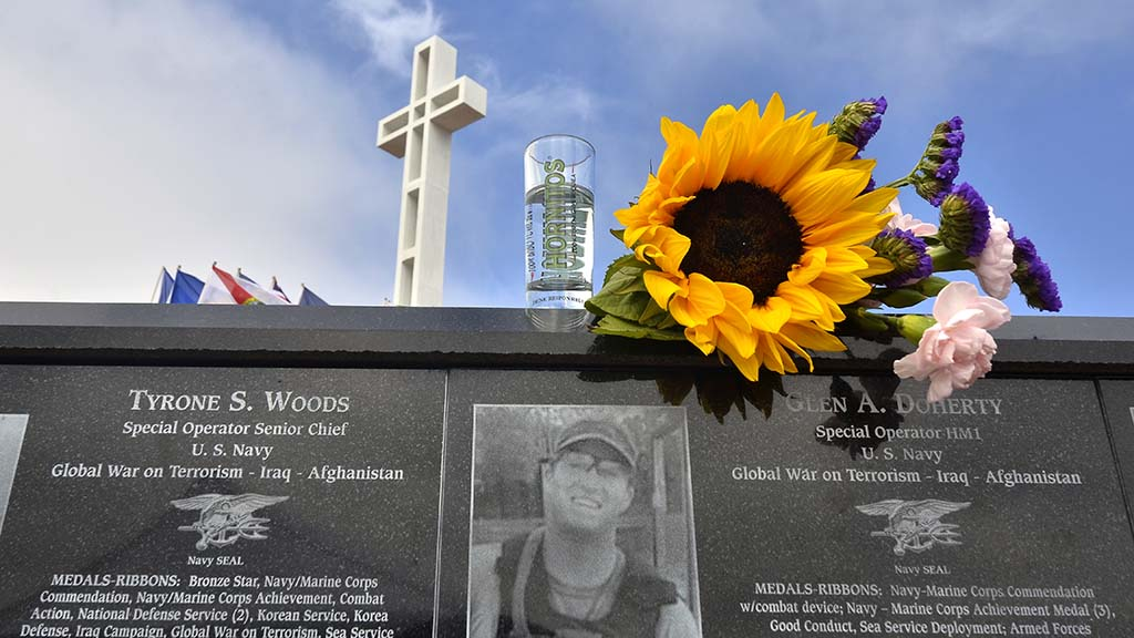 Flowers and a tequila glass were left at the plaque for Glen Doherty at Mt. Soledad National Veterans Memorial.