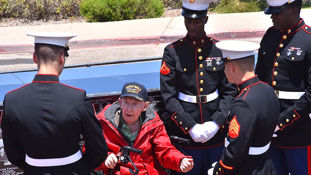 World War II veteran Joe Reilly of Santee tells Marines of his military service before a ceremony at Mt. Soledad National Veterans Memorial.