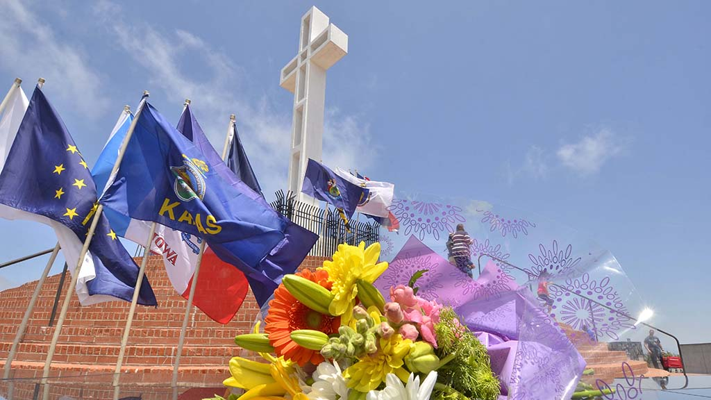 Flowers were left near plaques of loved ones at Mt. Soledad National Veterans Memorial.
