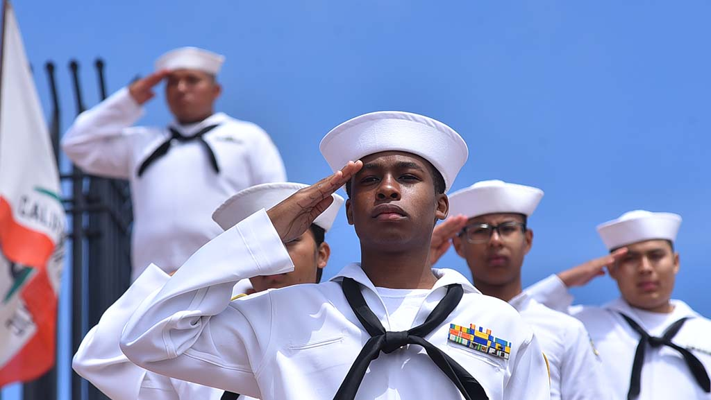 Sea Cadets salute during the national anthem at the Mt. Soledad National Veterans Memorial ceremony.