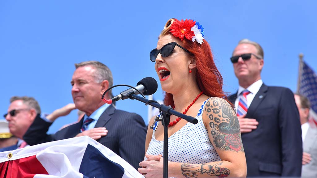 Tina Price of the Stilletos Band sang the national anthem at Mt. Soledad Memorial Day ceremony.