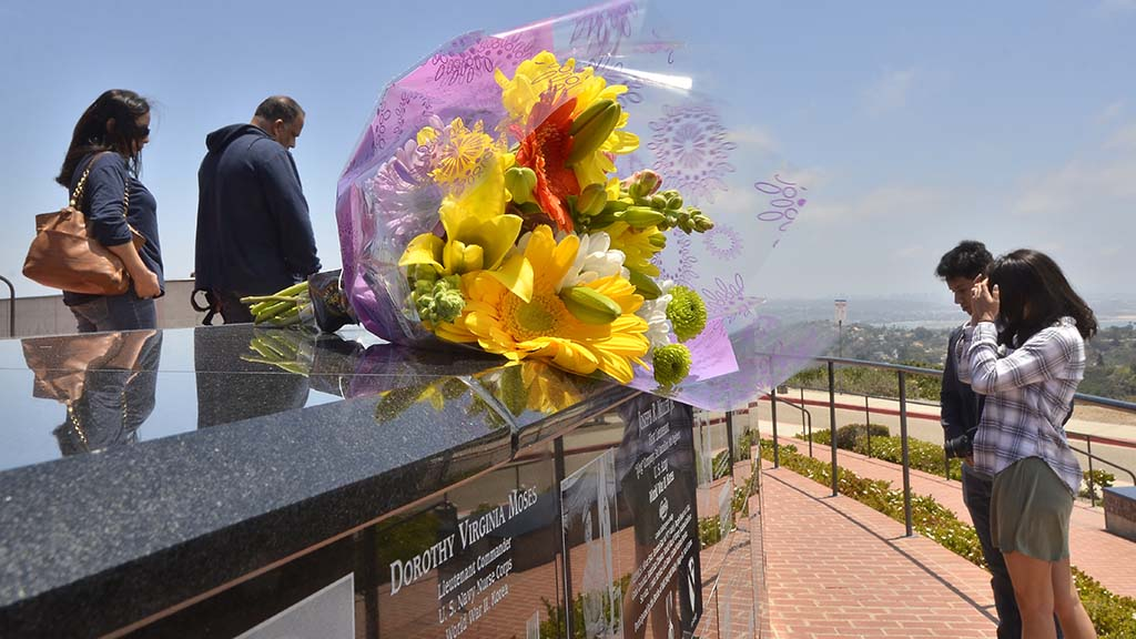 Flowers were placed near plaques of veterans and visitors read about the military persons.