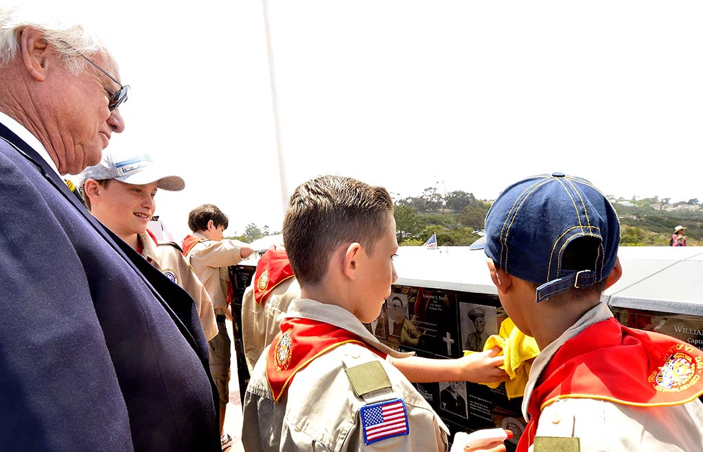 San Diego County Supervisor Bill Horn talks to boy scouts about his plaque at Mt. Soledad National Veterans Memorial