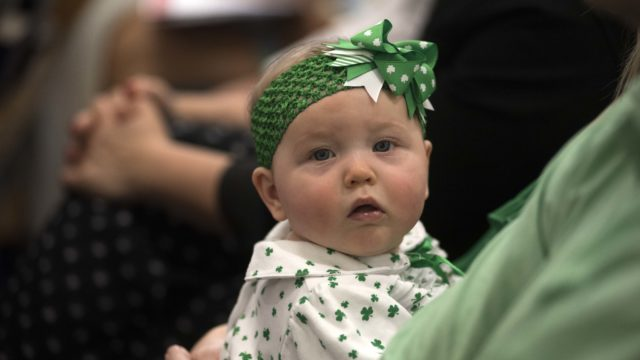An Irish family dressed their baby in shamrock clothing.