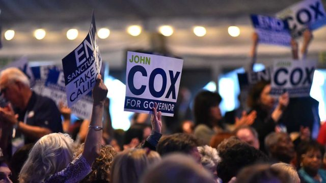 Delegates at the California Republican Party Convention show support of John Cox for governor.