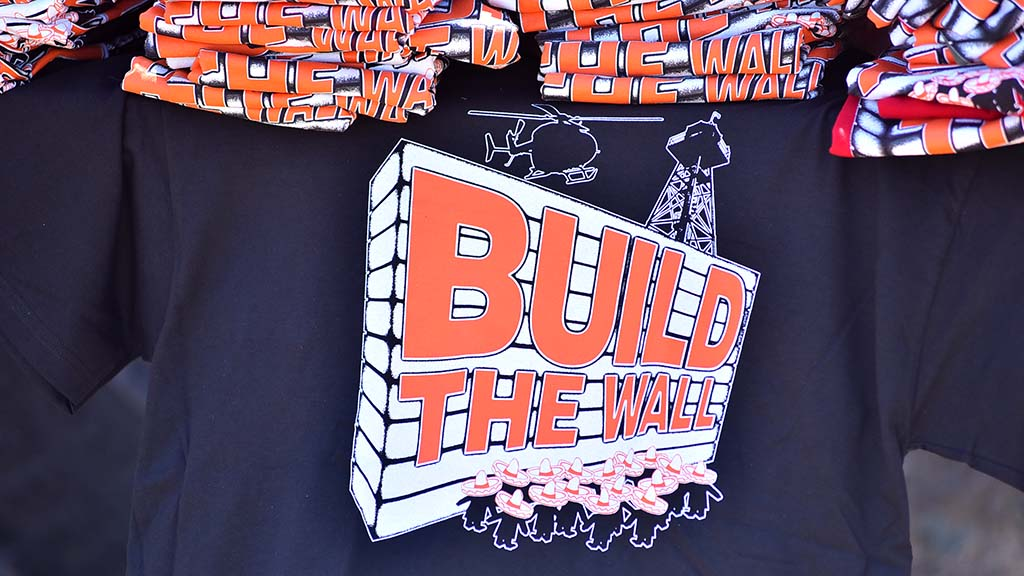 "A supporter was selling Build the Wall t-shirts. Allen led the crowd in the ""Build That Wall"" chant."
