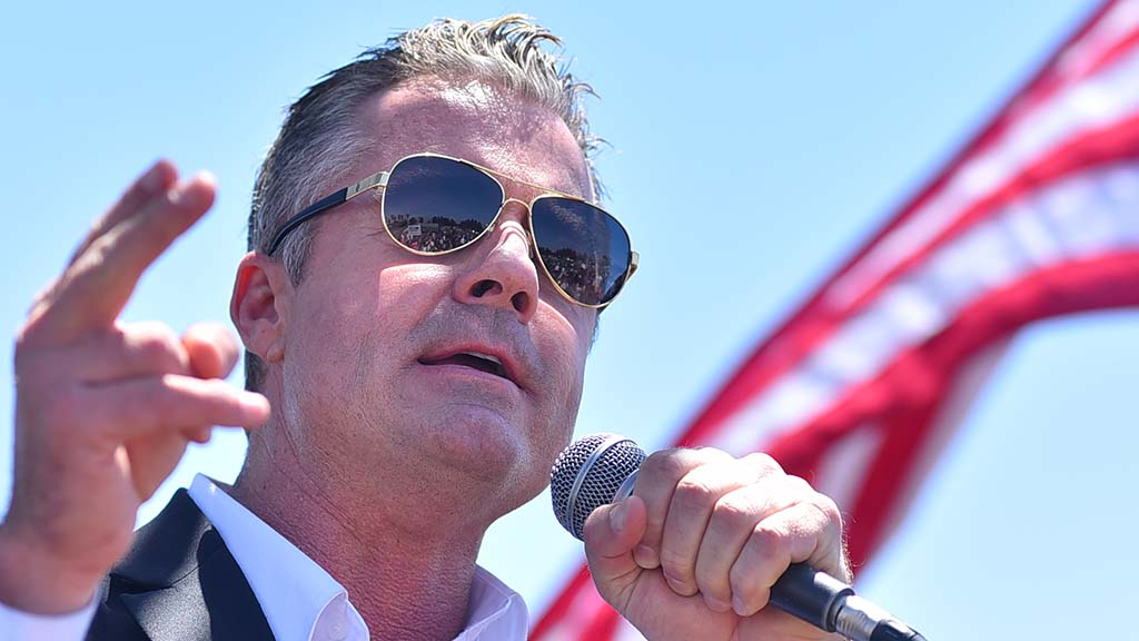 A crowd of supporters is reflected in Republican gubernatorial candidate Travis Allen's sunglasses.