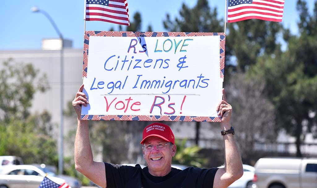 A man sends a message about support for legal immigrants.
