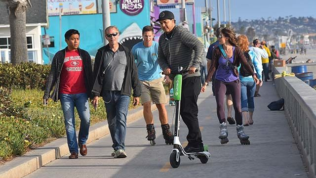 Dockless scooters on the Pacific Beach boardwalk