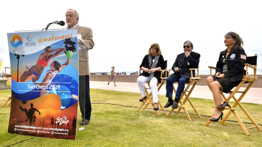Mike McDowell of the San Diego Tourism Authority addresses press conference at Mission Beach.