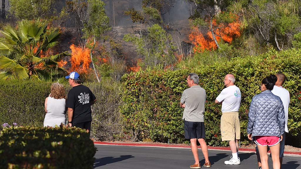Residents of a nearby housing development watched as firefighters put out a blaze in the Del Cerro area.