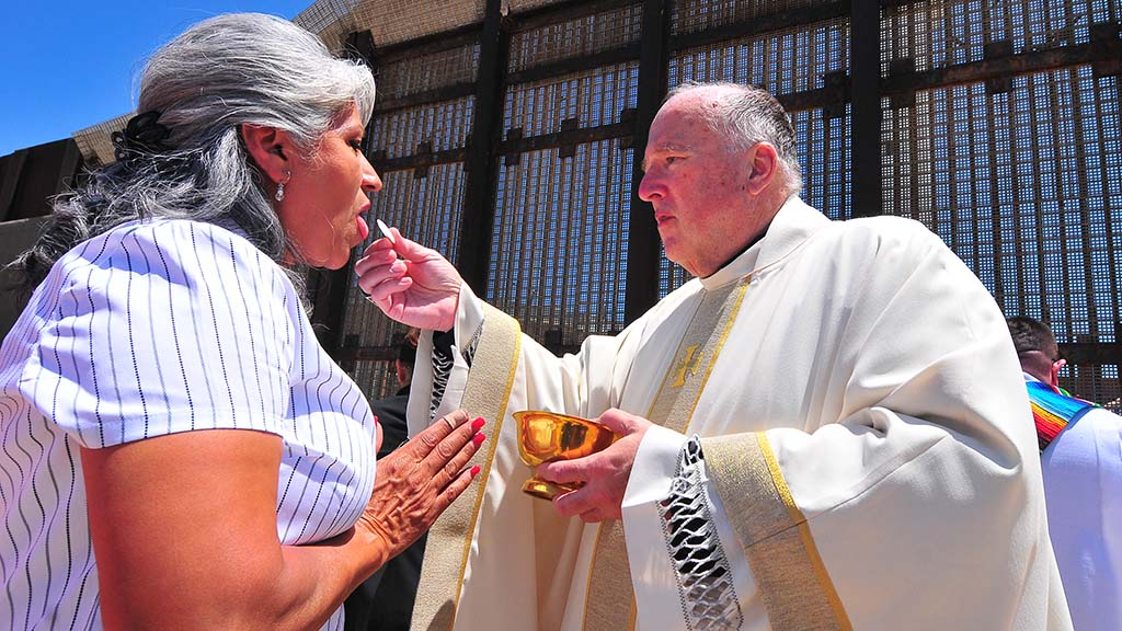 San Diego Bishop Robert McElroy distributes communion to those in attendance.