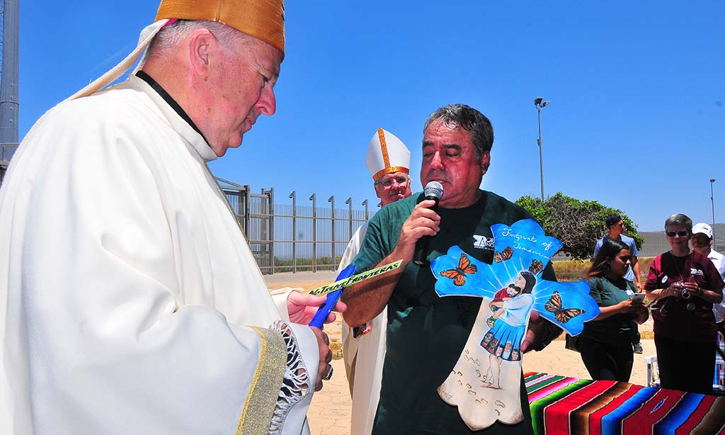 Border Angel founder and executive director Enrique Morones holds a cross that will be sent into Mexico, Central America and South America.