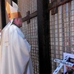 Associate San Diego Bishop John Dolan (left) and Bishop Robert McElroy stand at the Mexican border fence during a binational Mass.