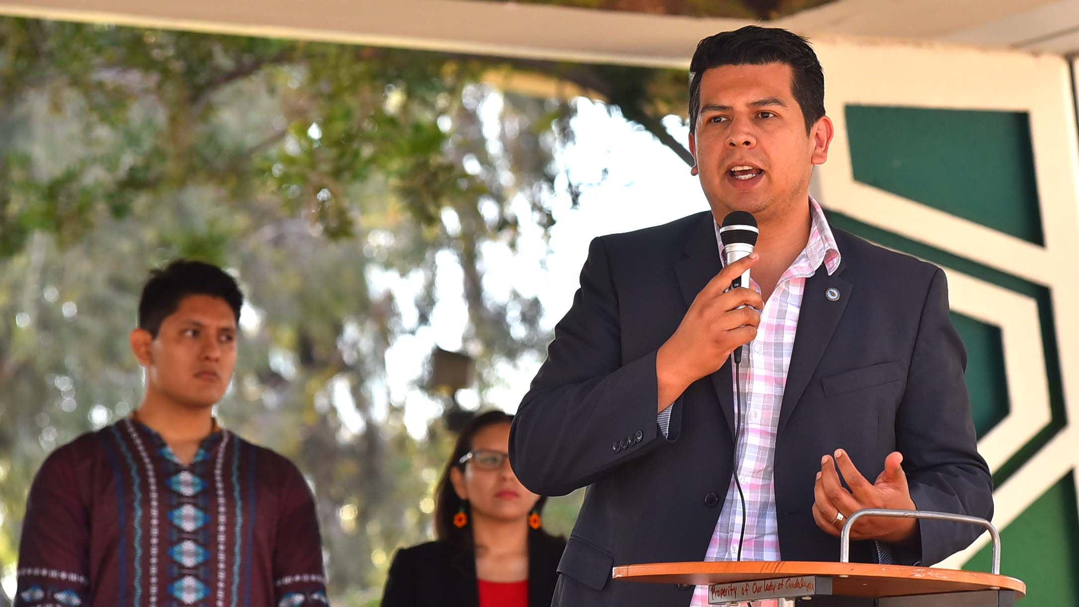 San Diego City Councilman David Alvarez speaks at a Chicano Park rally with Jesuit priests and community leaders.