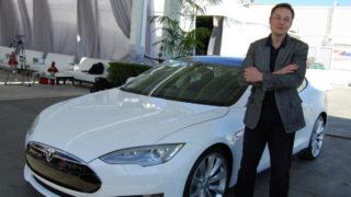 Elon Musck with a Tesla