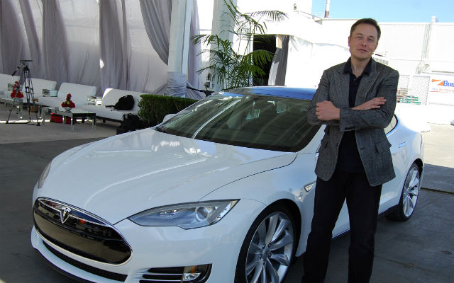 Elon Musck with a Tesla
