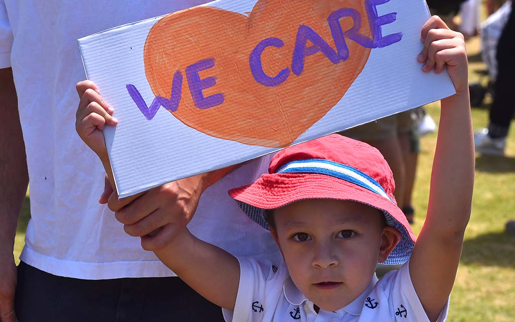 "Raul, 4, said, ""Families should be together,"" as he carried a sign."
